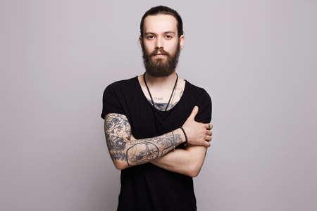 handsome bearded man.Brutal hipster boy with tattoo Foto de archivo