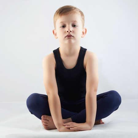 Little boy doing yoga