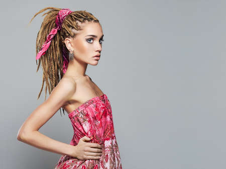 beautiful girl with dreadlocks hairstyle.trendy modern young woman with braids hairdo and make up 免版税图像 - 82692010