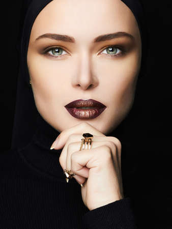 beautiful woman face.girl with make-up.fashion islamic style woman