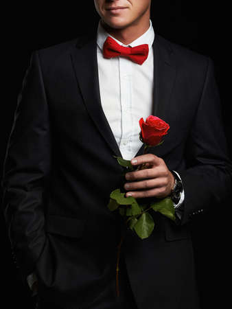 man with flower.young groom man in suit.elegant boy Stock Photo