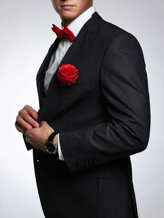 man with flower.young groom man in suit.elegant boy without face Stock Photo
