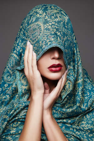 beautiful fashion islamic style woman face.cover face with a colored cloth.red lips girl Stok Fotoğraf