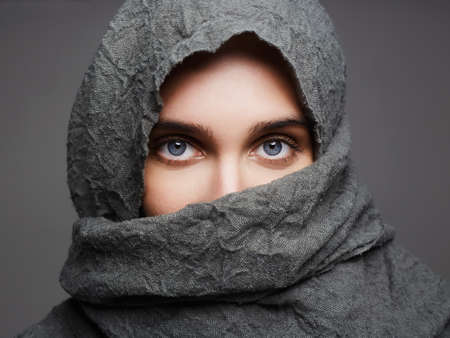 beautiful woman covers her face with hi jab.fashionable arabian style girl.beauty portrait