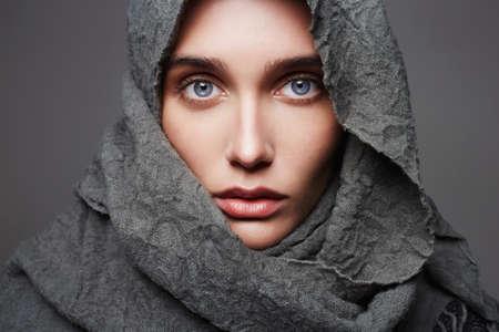 beautiful young woman in scarf.fashionable arabian style girl.beauty portrait