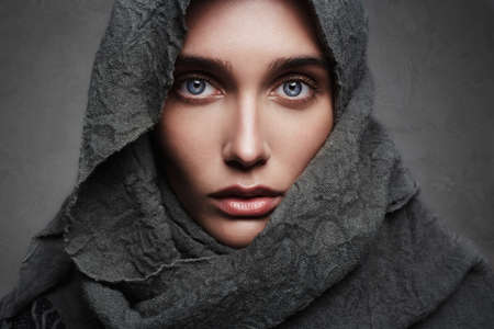 beautiful young woman in scarf.fashionable arabian style girl.beauty portrait
