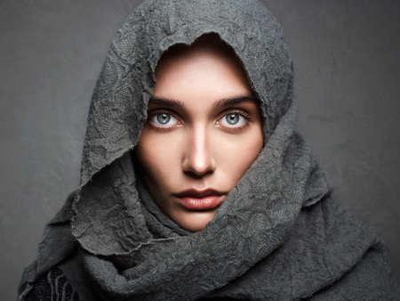 beautiful woman in scarf.fashionable arabian style girl.beauty portrait.beautiful eyes