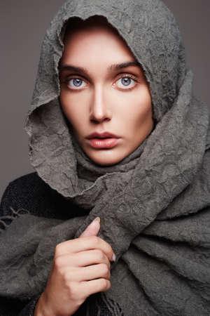 beautiful young woman in scarf.winter fashion girl portrait