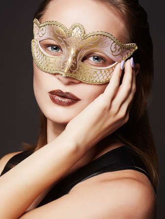 beautiful young woman in mask.Beauty model girl in Carnival Mask