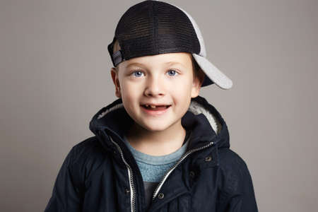 Fashionable smiling child in winter coat and hat.fashion kids.little boy