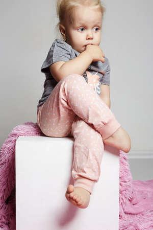 cute child girl sitting in studio.beauty fashion kid in pink panties