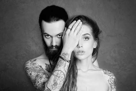 sexy beautiful couple with tattoo.beauty woman and handsome man.lovely boy and girl