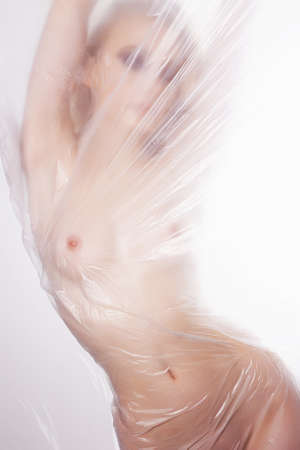 beautiful nude woman silhouette. girl in shower behind a polyethylene film. figure of a naked woman behind a transparent curtain Reklamní fotografie - 93269712