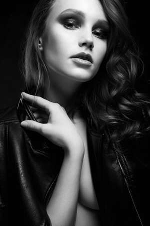 sexy Beautiful young woman in leather coat. black and white fashion portrait
