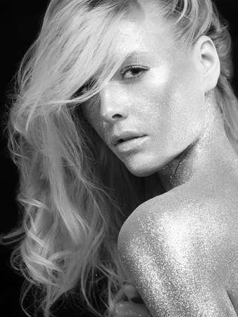 Silver Girl. Black and white Portrait of Beautiful Woman in Sparkles. Blond Hair Girl with Art Make-Up