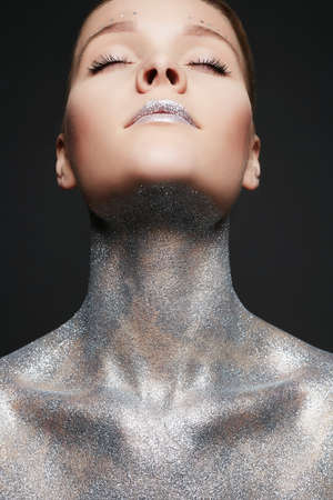 Silver Woman. Portrait of Beautiful Girl with Sparkles on Body and lips. Girl with Art Make-Up