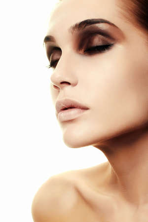 Beauty face makeup. Make up. Perfect Make-up closeup. Foundation. Cosmetic Eyeshadow, eyebrow. Beauty Girl with Perfect Skin. Makeover