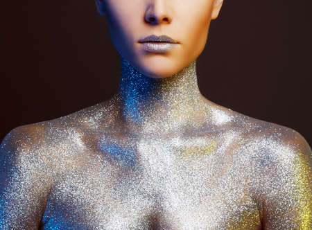 Portrait of Beautiful Woman with Sparkles on Body. Girl with Art Make-Up in color spotlights 版權商用圖片