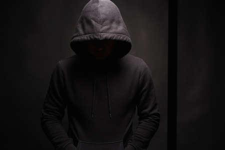 Man in dark, figure in a hooded sweatshirt. Incognito Boy