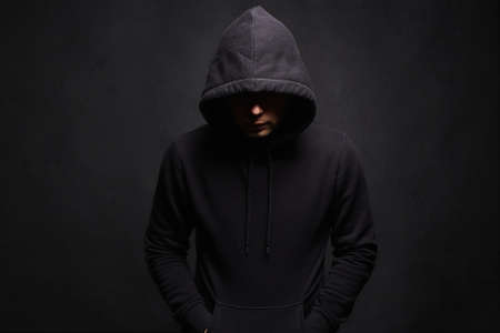 Man in Hood. Dark figure in a hooded sweatshirt. Incognito Boy