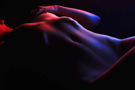 Rainbow Woman Body silhouette, in colorful bright lights posing Nude. Art design, colorful Naked girl  Archivio Fotografico
