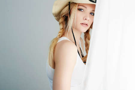 Beautiful Young Blond Country Woman. Cowgirl in Hat near the window Stock fotó