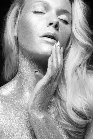 Silver Girl. Black and White beauty Portrait of Beautiful young Woman with Sparkles. Girl with Art Make-Up Stock Photo