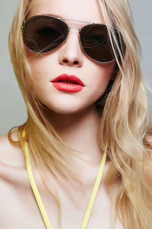 beautiful young woman in sunglasses.fashionable summer style girl with red lips and blond Hair