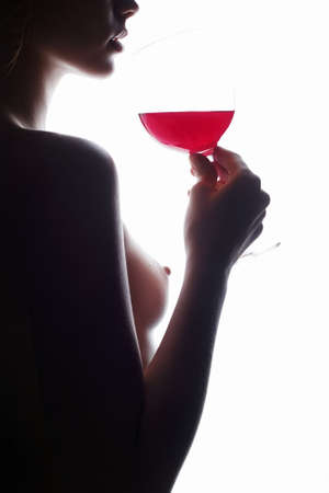 Nude Woman Drinking Wine. Naked Body Girl holding wineglass. Nudity Stock Photo