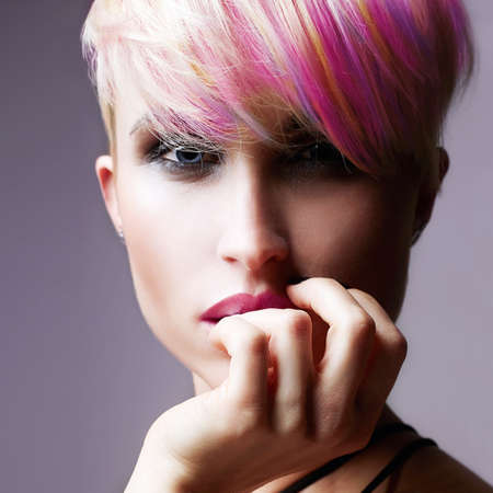 Short HAir Girl. Beauty Fashion Model Girl with Colorful Dyed Hair. Woman with perfect Makeup and Hairstyle. Rainbow Hairstyles