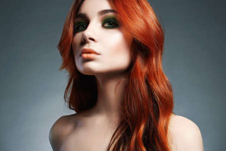 Beauty Girl Portrait. Healthy Red Hair. Beautiful Young Woman