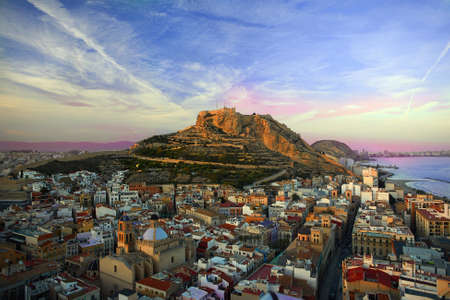 Beautiful Sunset in Alicante. Castillo de Santa Bárbara. view of the old city of europe. Stock Photo