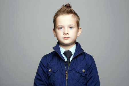 fashionable blue eyed boy. fashion hairstyle child portrait. elegant kid in tie