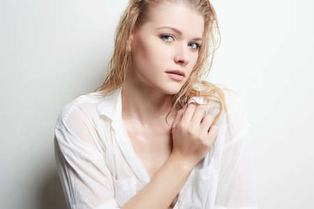 Wet Sexy Blonde Girl. Beautiful Woman with wet Hair and Body Stock Photo