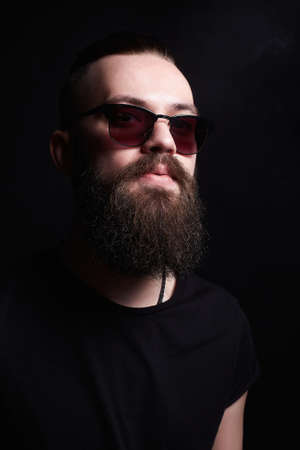 fashionable handsome man. Brutal bearded sexy boy in trendy glasses Stock Photo