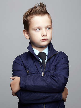fashionable child with trendy haircut. fashion little boy portrait. elegant kid in tie, business child, hair style