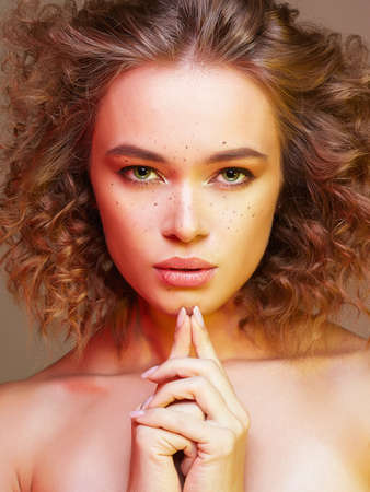 Beautiful woman in colorful Lights. amazing curly girl with make-up. beauty fashion portrait. frizzle hair Zdjęcie Seryjne