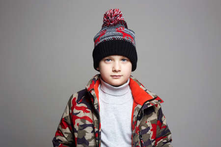 portrait of Fashionable Boy in winter outerwear. fashion kid. child. stylish teenager in hat