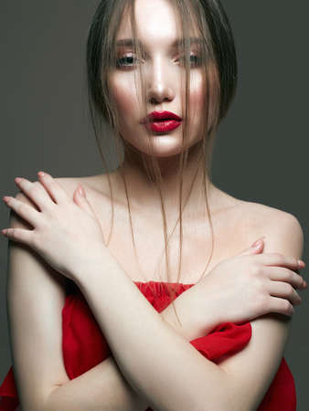 young beautiful sexy woman in red. Beauty sensual girl with red lips make-up