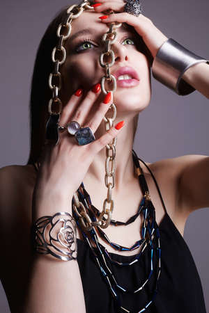 beautiful woman with jewellery. All in jewelry Model. fashion girl with beauty make-up and necklace, rings and bracelet