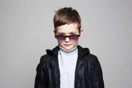 fashionable little boy in sunglasses. stylish kid in leather. fashion children
