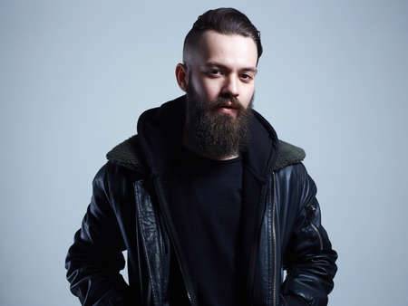 Fashionable young Man. Bearded Handsome Boy. Stylish hipster