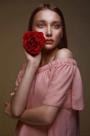 Beautiful young Woman with Flower. Lovely girl with beauty make-up and Rose. beauty portrait.wet makeup