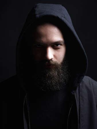 Handsome Man in Hood. Boy in a hoodie. portrait of bearded man