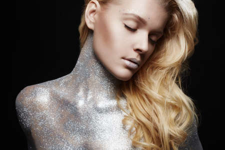 Silver Blond Girl. Beautiful Young Woman with Sparkles on her Body. Art Make-Up