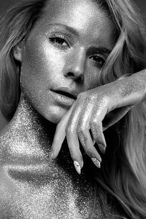 Silver Girl. Beautiful Young Woman with Sparkles on her Body. Black and white portrait Stock fotó