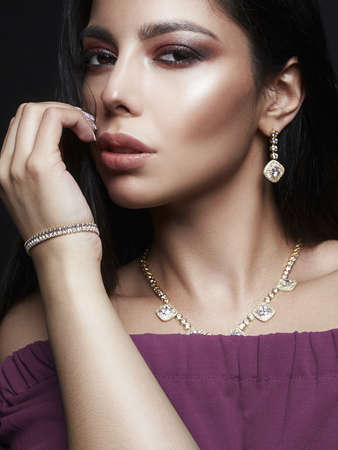 Beautiful Girl in Jewelry. Young Woman with Make-up and accessories