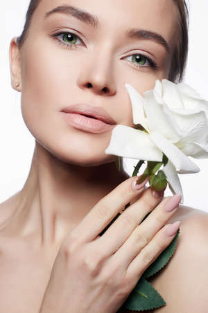 Beautiful Nude Make-up Woman with Flower. Beauty Portrait of girl with White Rose Flower. Clean Face, care Stok Fotoğraf