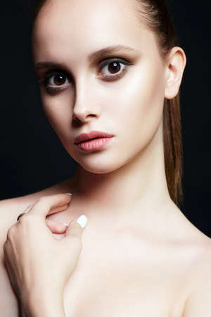 beautiful girl with big brown eyes. young woman with make-up. Beauty Fashion Portrait. Fresh Face Фото со стока