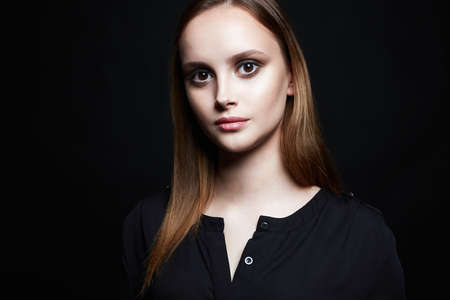 simple beautiful girl over black background. young woman with make-up. Beauty Fashion Portrait Фото со стока